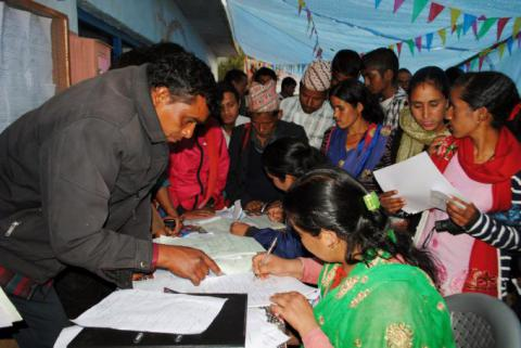 Youths and parents filling their resume for jobs