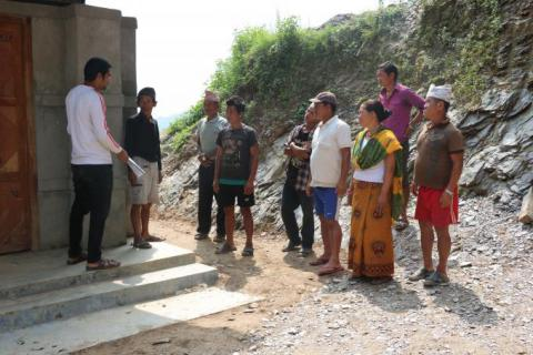 LIl Kumari with School Management Committee to inspect the construction work.