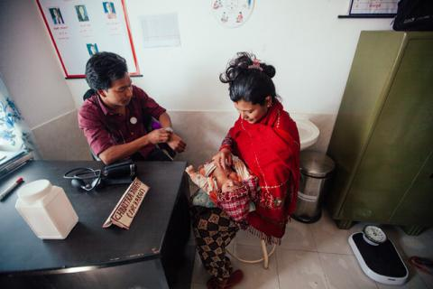 Rupa brings her two month old baby for a check up at a newly built semi-permanent Taruka Health Post